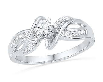 Diamond Engagement Ring with 1/2 CT. TW. Styled in Sterling Silver or White Gold