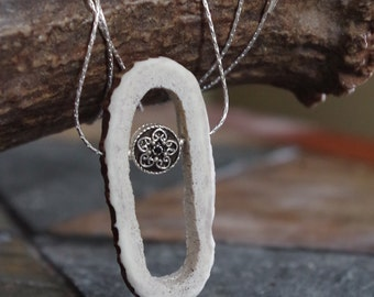 Unique and stylish! Hollowed elk antler necklace on silver chain