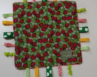 Cuddly sensory Ribbon. Blanket toy. Ladybug blanket. The blanket as a gift. Red and green blanket. Toy ribbons. Baby gift.