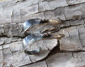Hammered hoop earrings.