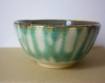Green, white, and earth-colored bowl with organic exterior pattern - beautiful clay pottery - functional handmade stoneware