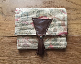 Collection colors faded old fabrics and leather pouch