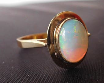 Fine quality vintage Opal ring, large high domed solid opal cabachon set in 10k yellow gold, fiery multi-colour range, excellent condition