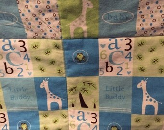Soft flannel baby or toddler quilt just for Boys - Blue Giraffe's, numbers, and letters.