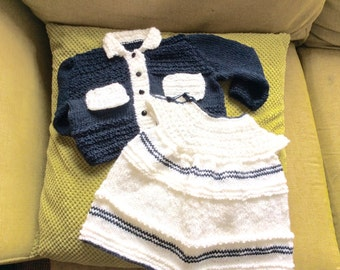 Hand knitted baby's dress and jacket. Vintage styled dress with seed stitch detail matching jacket.