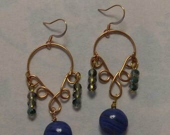 The Blues Handmade copper earrings with a large swirled glass blue bead and small dark ocean colored faceted glass beads