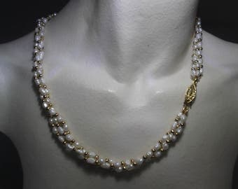Necklace irregular pearls of river and golden balls