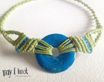 light green macrame necklace with blue doughnut stone