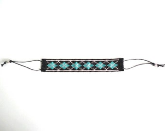 SALE!!! Woven beaded Bracelet by miyuki beads No. 11 finished with faux suede and candle rope.