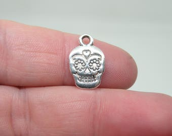 5 Silver Tone Day of the Dead Skull or Sugar Skull Charms. B-012