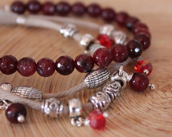 Bracelet with semiprecious stones, charms and Red crystals.