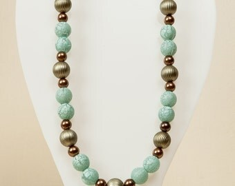 Turquoise and metallic beaded necklace.