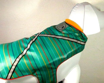 New! Waterproof, day&night safety rainwear in multi colors on green for your dog