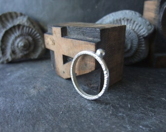 Edge-hammered silver bead ring