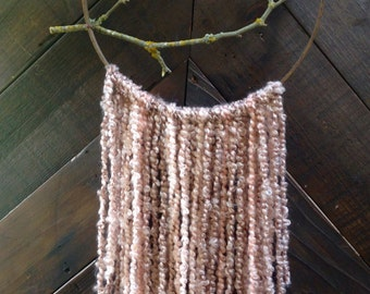 Yarn and branch wall hanging