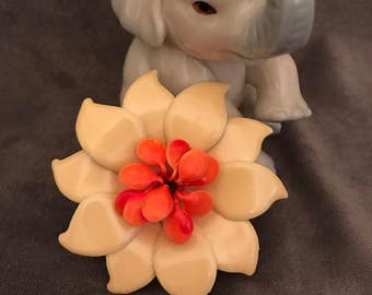 Vintage Bakelite yellow and coral colored flower