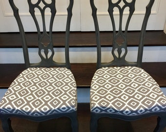 Pair of upholstered dining chairs painted in Annie Sloane 'graphite' chalk paint and grey/cream graphic print fabric