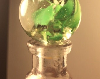 Green swirl glass marble, one crease pontil and one pinch pontil.