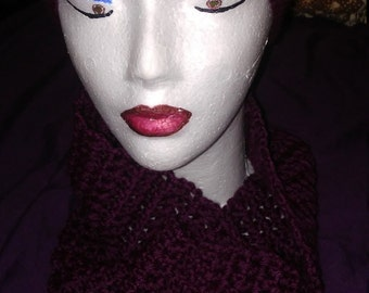 Crocheted hat and infinity scarf.