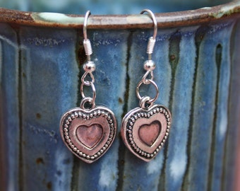Silver-plated pink heart dangle earrings with fish hooks