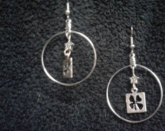 Silver Hoop Earrings with 4 Leaf Clovers and Stars