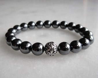 Hematite bracelet with sterling silver bead