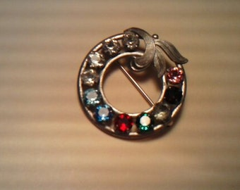 1  VINTAGE STERLING SILVER brooch with clear & colored rhinestones