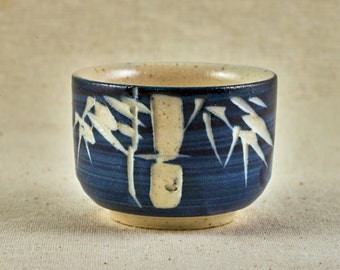 Japanese tea cup with bamboo ornament. Vintage Japanese ceramic.