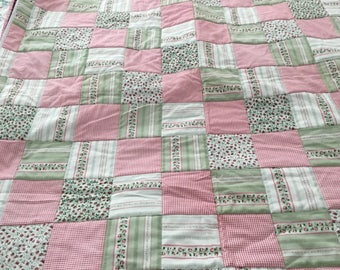 Pretty baby girl quilt in pinks and greens.  41x41