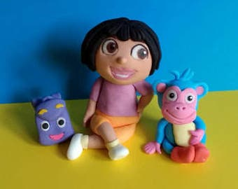 Dora cake topper with Boots and backback