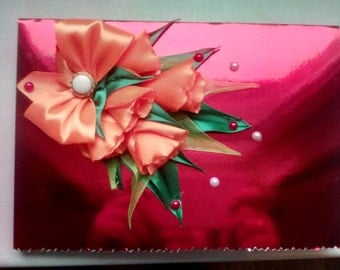 Greeting card with flowers from ribbon