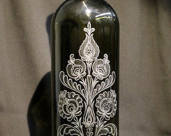 Hand engraved design glass bottle