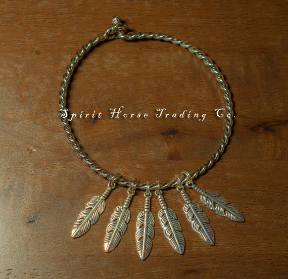 "Native American Feather Bangle Bracelet with feather charms on silver metal rope. 3"" diameter."