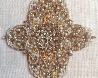 Beaded motif in gold and silver for applique.