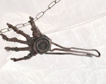 Upcycled metal art hand sculpture by New Mexico artisan