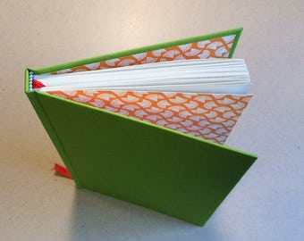 Hand bound A5 blank Journal notebook full lime green bookcloth cover with made end papers using orange decorative paper hardback bookbinding