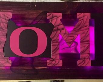 Handcrafted backlit LED Pink Oregon Ducks sign.