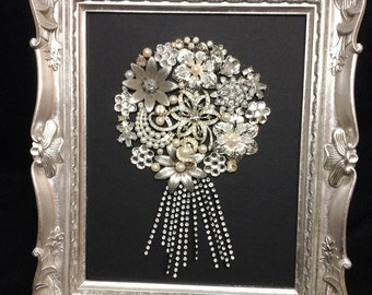 Large silver framed floral jewelry design