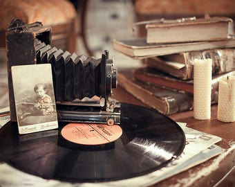 Old camera and vinyl records with other old stuff