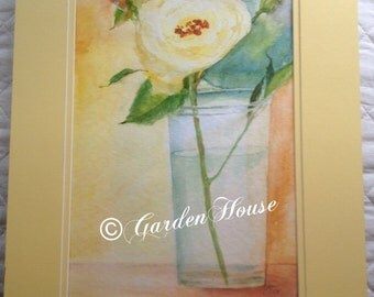 Original watercolor of yellow rose in glass vase double-matted in yellow