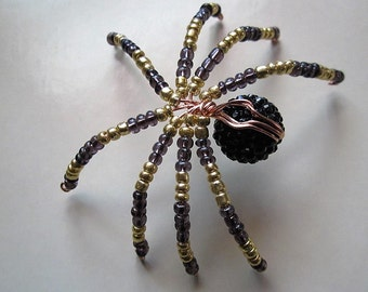 1  BEADED SPIDER ,Black,Gold,Clear Purple.