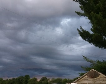 Stormy Sky Photograph Over Rustic Garage