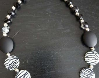 Show your wild side with this black and white zebra choker