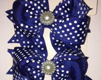 Blue with white polka dots shoe bows that come with a magnetic snap to attach to SASSAFLATS shoes they can also be worn in the hair