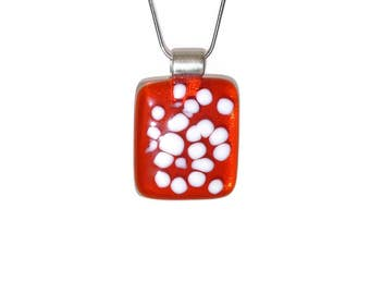 Red fused glass pendant with white dots