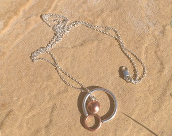 Silver and copper circle necklace.