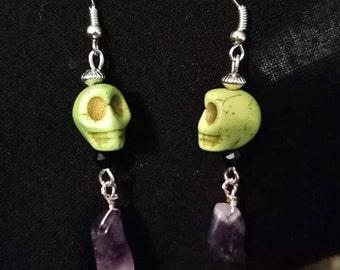 green skull earrings with a amethyst drop