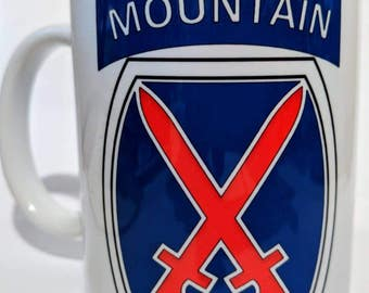 10th Mountain coffee mug with golden dragons on the other side