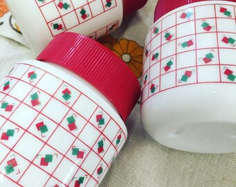 1980s Red, White And Green Geometric Diamond Patterned Milk Glass Storage Jars With Plastic Lids x 3