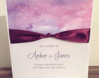 Watercolour themed wedding invitation stationery